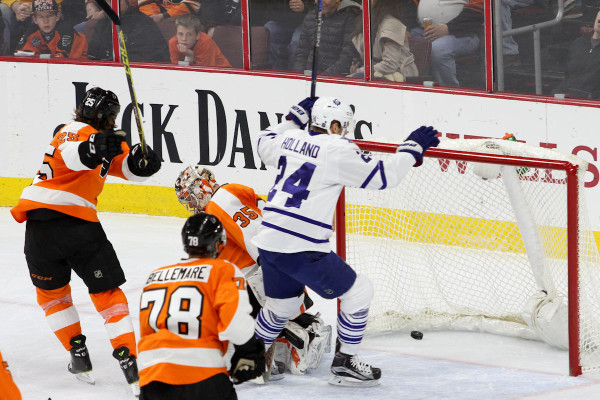 Center Peter Holland (#24) of the Toronto Maple Leafs scores a goal against Goalie Steve Mason (#35) of the Philadelphia Flyers during the second period