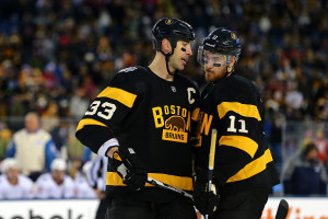 FOXBORO, MA - JANUARY 01: Zdeno Chara #33 and Jimmy Hayes #11 of the Boston Bruins speak in the third period against the Montreal Canadiens during the 2016 Bridgestone NHL Winter Classic at Gillette Stadium on January 1, 2016 in Foxboro, Massachusetts.  (Photo by Maddie Meyer/Getty Images)