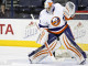 Thomas Greiss (NYI - 1) makes a save during warmups.