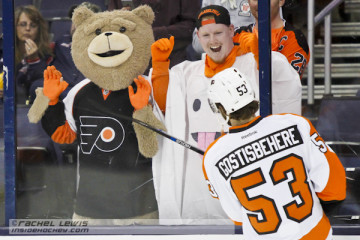 Shayne Gostisbehere (PHI - 53) acknowledges fans during warmups.