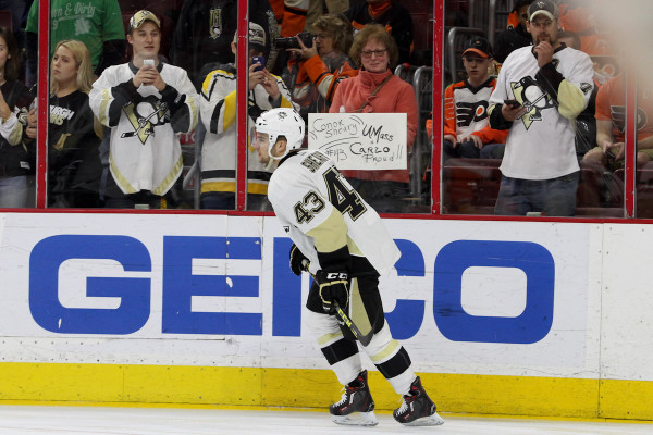 Left Wing Conor Sheary (#43) of the Pittsburgh Penguins skates past a fan holding a sign during the warm-ups
