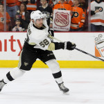 Defenseman Kris Letang (#58) of the Pittsburgh Penguins shoots the puck during the warm-ups