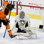 Right Wing Wayne Simmonds (#17) of the Philadelphia Flyers screens Goalie Marc-Andre Fleury (#29) of the Pittsburgh Penguins during the first period