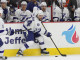 Right Wing Ryan Callahan (#24) of the Tampa Bay Lightning handles the puck during the second period