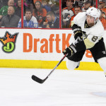 Defenseman Brian Dumoulin (#8) of the Pittsburgh Penguins passes the puck during the second period