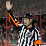 Referee Steve Kozari (#40) signals a call during the second period