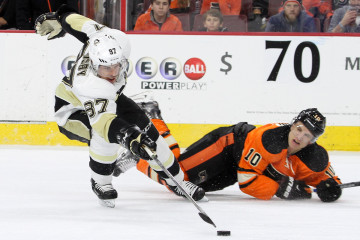 Center Sidney Crosby (#87) of the Pittsburgh Penguins reaches for the loose puck during the second period