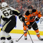 Center Claude Giroux (#28) of the Philadelphia Flyers skates against Left Wing Carl Hagelin (#62) of the Pittsburgh Penguins during the third period