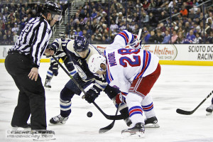 Alexander Wennberg (CBJ - 41) faces off against Dominic Moore (NYR - 28).