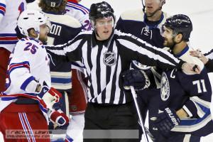 NHL linesman Matt MacPherson separates Viktor Stalberg (NYR - 25) and Nick Foligno (CBJ - 71).