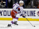 Chris Kreider (NYR - 20) skates the puck down the ice.