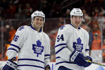 Right Wing Tobias Lindberg (#46) and Center Frederick Gauthier (#54) of the Toronto Maple Leafs smile during the warm-ups