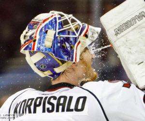 Joonas Korpisalo (LEM - 70) sprays himself down during a media timeout.