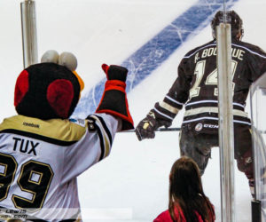 WBS Penguins mascot Tux tries to distract Ryan Bourque (HER - 14).