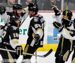 Jarrett Burton (WHL - 20) celebrates his goal with teammates.