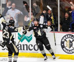 Derek Army (WHL - 16) celebrates his game-winning goal.