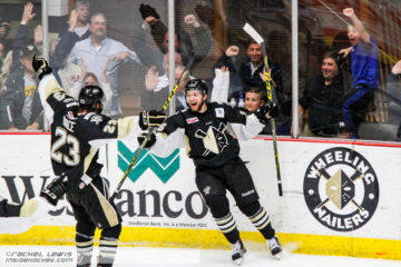 Derek Army (WHL - 16) celebrates his game-winning goal.