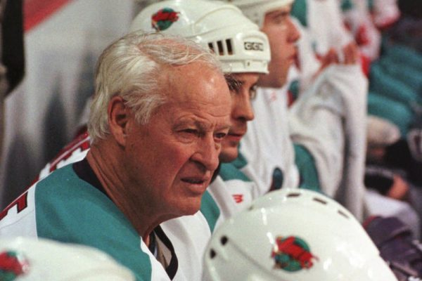 Gordie Howe sits on the Detroit Vipers' bench with his International Hockey League teammates during the first period against the Kansas City Blades in Auburn Hills, Mich., on Friday, Oct. 3, 1997. Howe, 69, who played a 48-second shift in the first period, became the first professional hockey player to play in six decades.(AP Photo/Jeff Kowalsky) ORG XMIT: DTP106