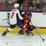 Mikey Anderson (#2 - White) covers Kailer Yamamoto (#18 - Blue)