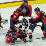 Grant Mismash (#15 - White) gets surrounded by members of Team Howe (Blue)