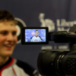 Cayden Primeau (#30 - White) gives a post-game interview