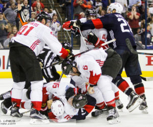 Players from both Team USA and Team Canada get into a kerfuffle.