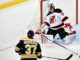 New Jersey Devils goalie Cory Schneider (35) looks for the puck after a shot from Boston Bruins center Patrice Bergeron (37) during a NHL game.