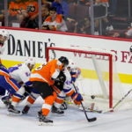 Center Mikhail Vorobyev (#46) of the Philadelphia Flyers sends the puck through the crease