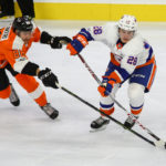 Center Anthony Salinitri (#86) of the Philadelphia Flyers uses his stick to impede Defenseman Sebastian Aho (#28) of the New York Islanders
